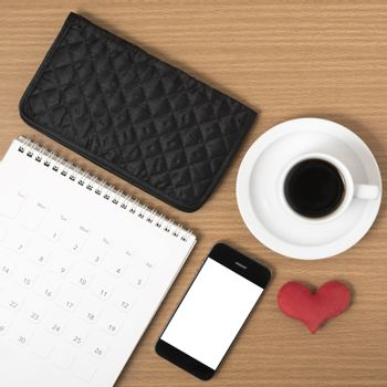 office desk : coffee with phone,wallet,calendar,heart on wood background