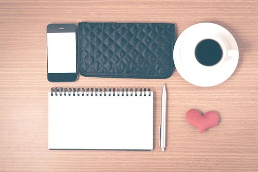 desktop : coffee with phone,notepad,wallet,heart on wood background vintage style