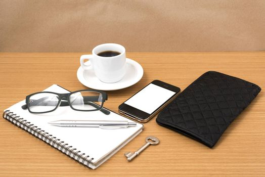 coffee and phone with notepad,key,eyeglasses and wallet on wood table background