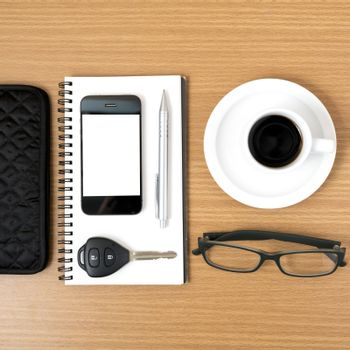 coffee and phone with notepad,car key,eyeglasses and wallet on wood table background