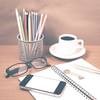 office desk : coffee and phone with key,eyeglasses,notepad,pencil box vintage style
