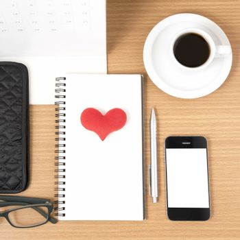 office desk : coffee with phone,wallet,calendar,heart,notepad,eyeglasses,heart on wood background
