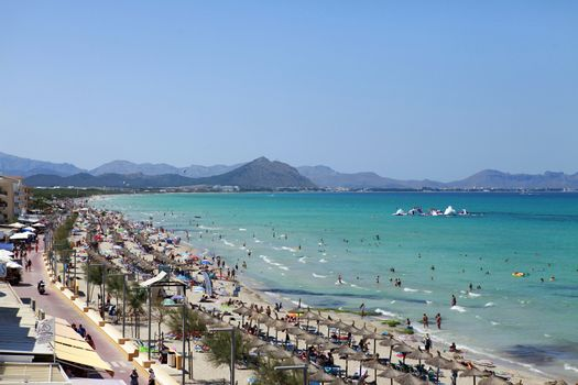 Mallorca, Spain - June 29, 2015: The tourists enjoiying their vacation on the beach. Up to 60 mln tourists is expected to visit Spain in year 2015.