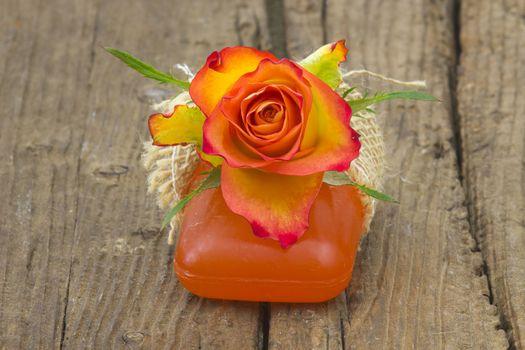 bar of natural soap and rose