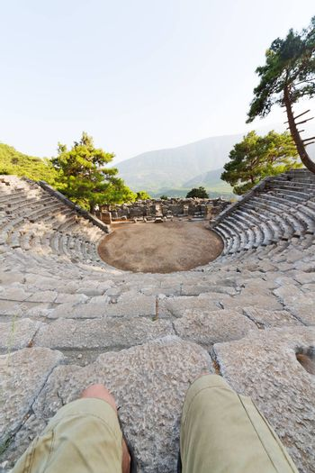 ruins stone and theatre in  antalya  legs