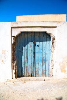 blue door in  village   white wall