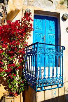 blue door in antique village flower   white wall