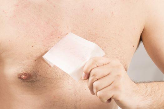 Waxing man torso depilation