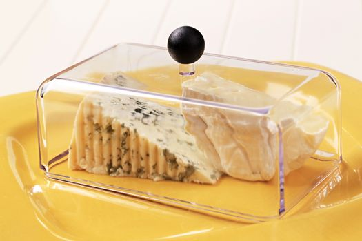 Cheeses under lid
