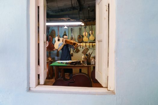 Lute Maker Checking Classic Guitar In Atelier Of Music Instrumen