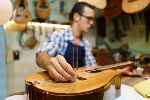 Artisan Lutemaker Tuning Handmade Classic Guitar With Diapason