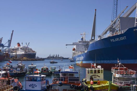 Variety of ships and boast in the busy harbour of the UNESCO World Heritage port city of Valparaiso in Chile.