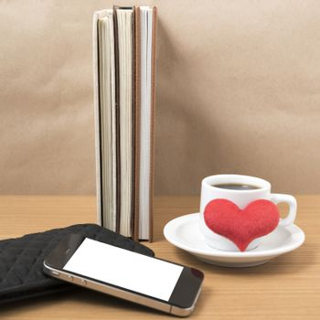 working table : coffee with phone,stack of book,wallet and heart on wood background