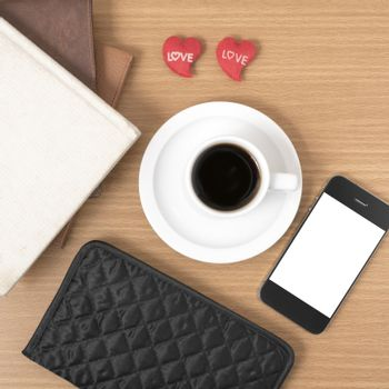 office desk : coffee with phone,heart,stack of book,wallet on wood background