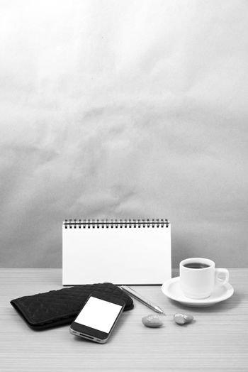 working table : coffee with phone,notepad,wallet and red heart b