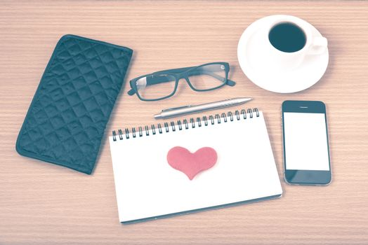 office desk : coffee with phone,notepad,eyeglasses,wallet,heart