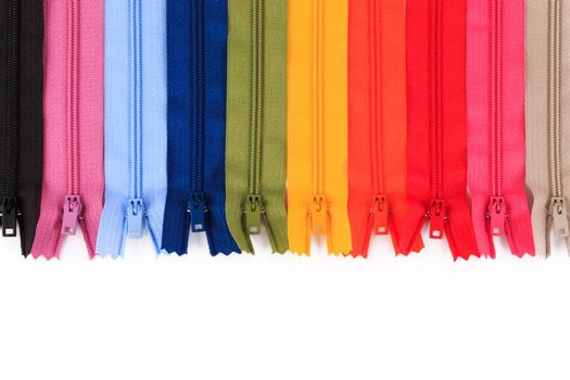 Colorful Zippers in different colors on white background.