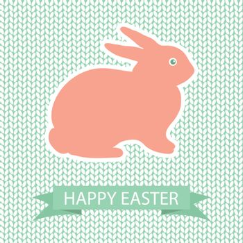 Easter card with pink rabbit on wool knited background