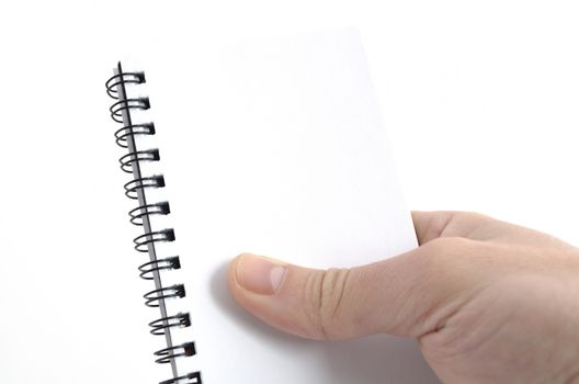 Business man hand and notebook isolated on white