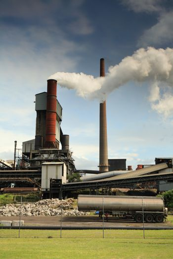 Active steel mill smelter emiting billowing toxic fumes