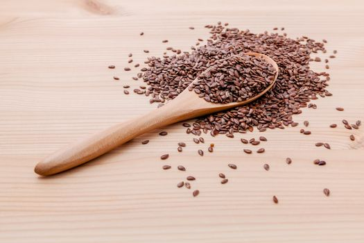 Nutritious flax seeds in wooden spoon for diet food ingredients