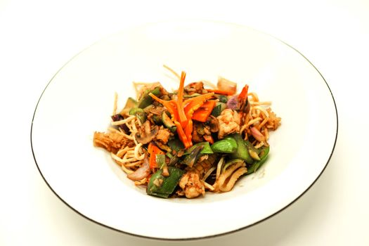 The Chinese fried noodles with squids, an octopus and vegetables.