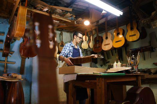Artisan Lute Maker Storing Guitar Music Instrument In Case For C