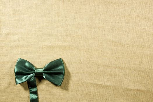 Bow tie on a background of white linen napkins