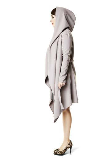 Side view of  fashionable woman. Lookbook photo.