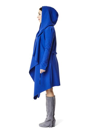 Side view of woman in blue coat. Isolated on white background.