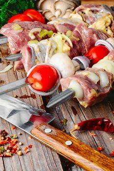 raw meat on skewer