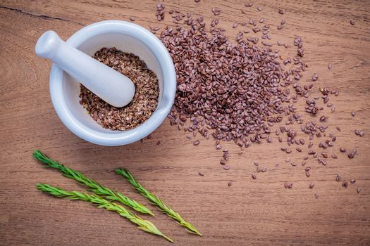 Nutritious flax seeds in white mortar for diet food ingredients