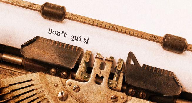 Vintage typewriter  - Don't Quit determination message