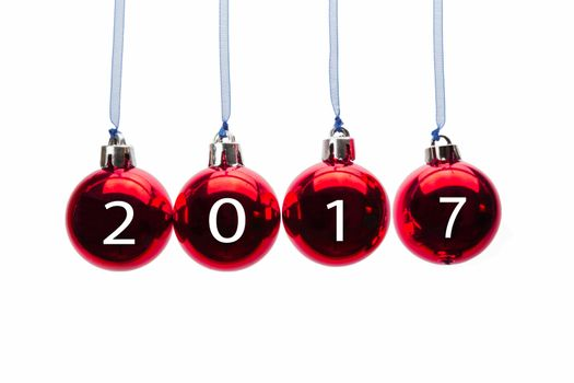 Four red christmas balls with new year 2017 numbers