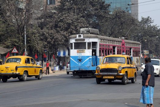 Traditional tram downtown Kolkata. Kolkata is the only Indian city with a tram network, which is operated by the Kolkata Tramways Comp.