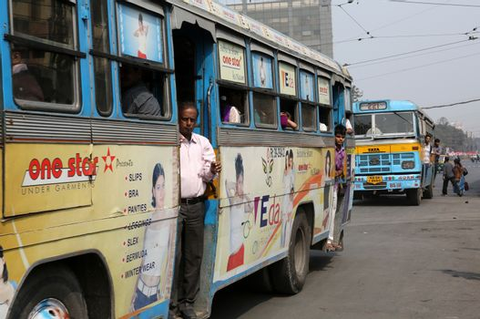 People on the move come in the colorful bus in Kolkata, India.