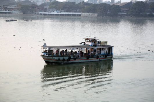A boat crossing the Hoogly river in Kolkata during sunset