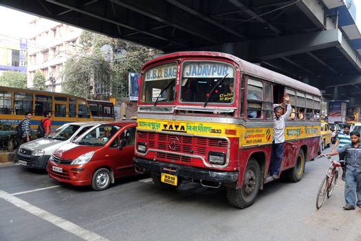 People on the move come in the colorful bus on February 10, 2013 in Kolkata, India.