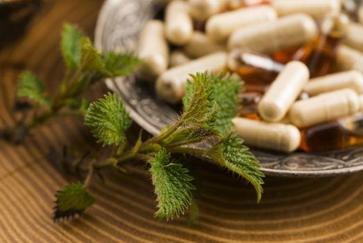 pills with herbs, macro
