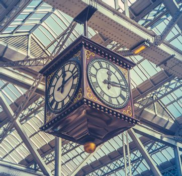 Retro Image Of The Vintage Clock And Meeting Point Under The Glass Roof Of Glasgow Central Station