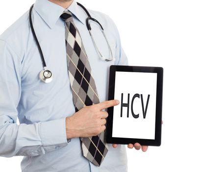 Doctor, isolated on white backgroun,  holding digital tablet - HCV
