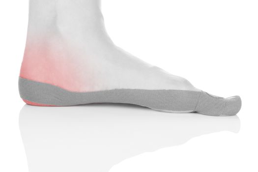 Therapeutic tape on female heel isolated on white background. Chronic pain, alternative medicine. Rehabilitation and physiotherapy.