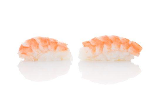 Delicious luxurious nigiri sushi with shrimp isolated on white background. Minimal contemporary asian style.