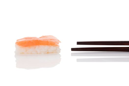 Delicious luxurious nigiri sushi with salmon and chopsticks isolated on white background. Minimal contemporary asian style.