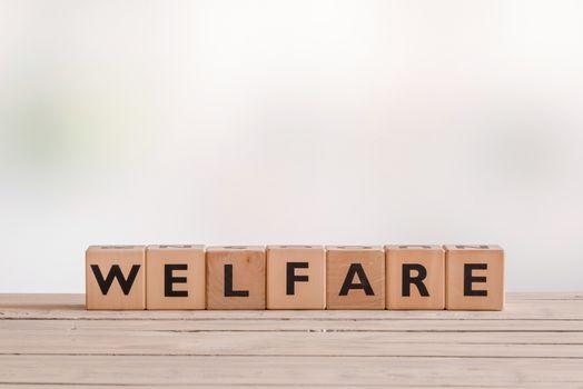Welfare sign made of wooden cubes