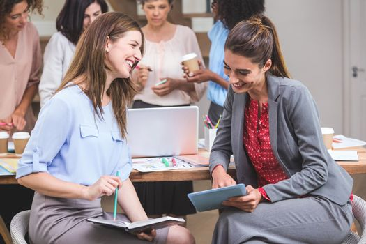 Group of interior designer interacting with each other in office