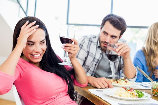 Man looking drunk woman with wine glass