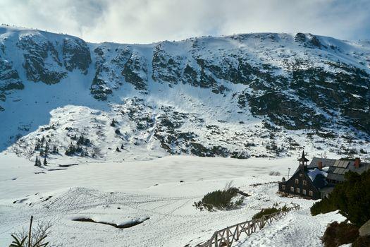 Frozen lake and tourist hostel