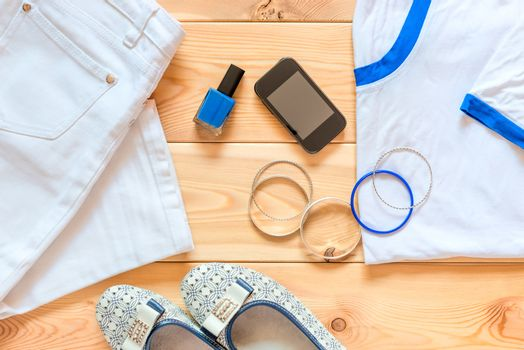 women's clothing and accessories on the wooden floor