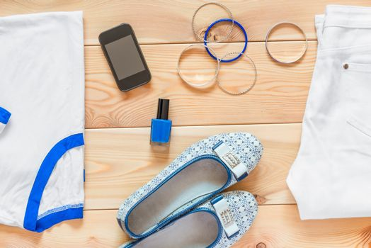 women's clothing and matching accessories on wooden boards